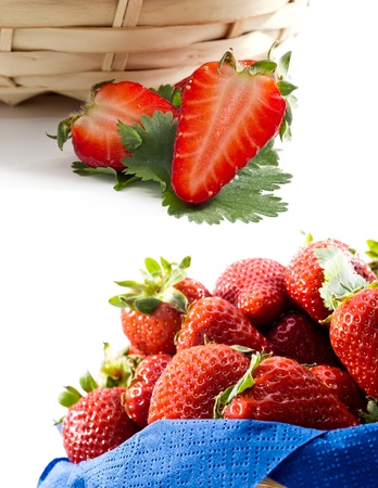 whote: a strawberries basket with a knife and jam packged on whote bakground Stock Photo