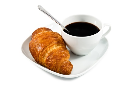 breakfast with cup of black coffee, croissant on white plat isolated on wite background photo