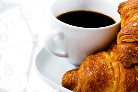 a cup of coffee with croissant on clock time background photo