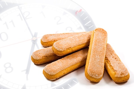 several ladyfinger biscuits on clock photo
