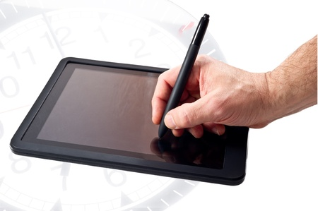 tablet pc and pen isolated on clock's background photo
