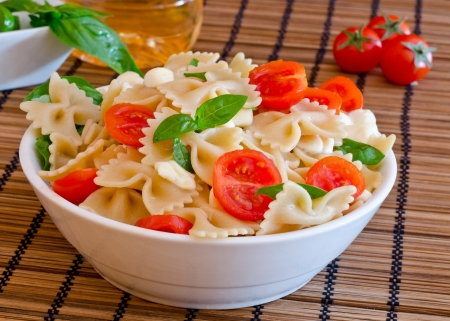 pasta with italian cheese  mozzarella , basil  and red tomatoes