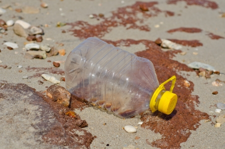 polluted river: generic plastic waste accumulates on the beach Stock Photo