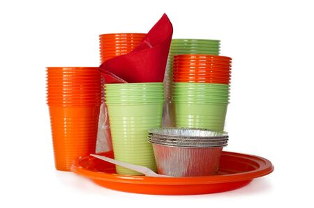 bright colored plastic tableware isolated on white photo