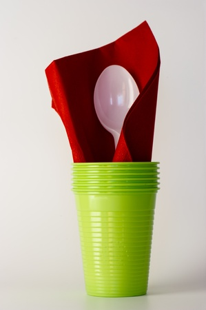 Plastic spoon  and plastic glass photo