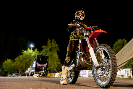 tdk: MILAN, ITALY - SEPTEMBER 14: Unidentified motodriver by TDK Motorsport group    during the  night event Motocross Freestyle Air Contest  on September 14, 2013 in Milan, Italy.