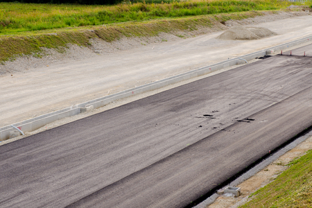 asphalting: Blach patch asphalt and asphalting the road  Stock Photo