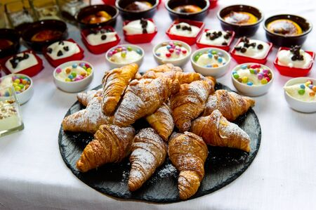 mixed croissants in white table for continental breakfast photo