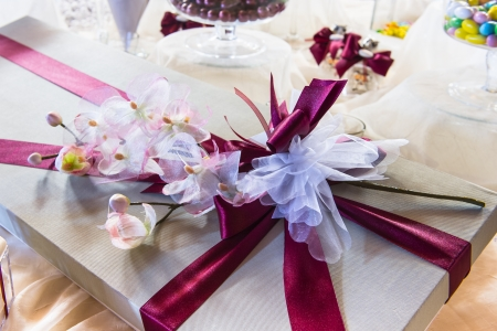 Wedding  or valentine gift with flowers over an elegant white table Stock Photo - 23456160