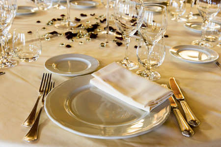 Fancy table set for a wedding dinner on evening light photo