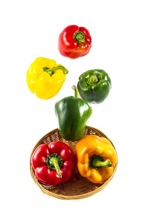 mixed colorated peppers on white background photo