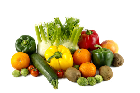 mixed colorated vegetables on white background photo