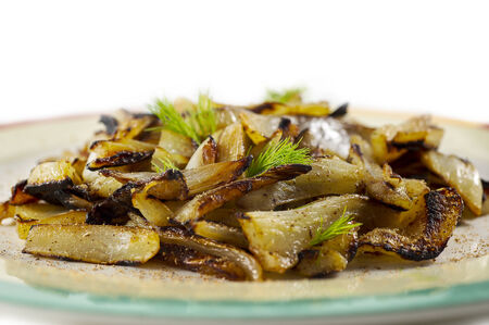 Baked fennel slices  on white background photo