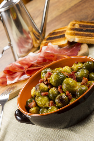 Fried Brussel Sprouts with ham called 'speck' photo