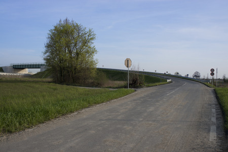 Country road corner with a bridge