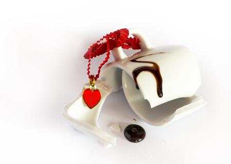 Broken white mug with a little red heart