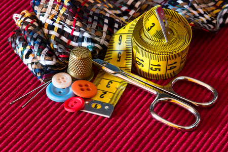 sewing kit accessories on red texture photo
