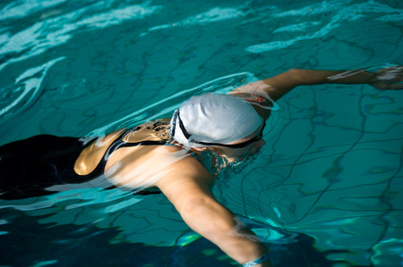 a swimmer under water in swimming pool