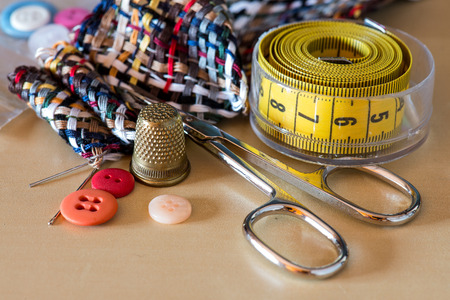 sewing kit accessories on wooden table photo