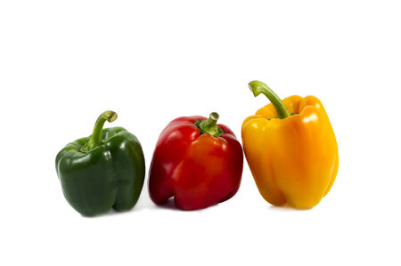 colored peppers over white background photo