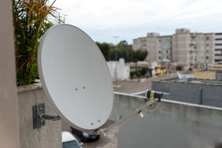television aerial:  white satellite dishes