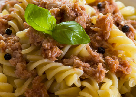 italian pasta with tuna, black pepprs , white whine  and tomatoes photo