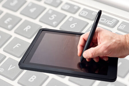 pen tablet: pen tablet on keyboard  background