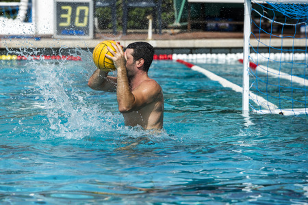 summer olympics: water polo players on swimming pool Editorial