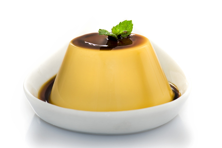 Creme caramel , Caramel custard , Custard pudding in white plat on  white background