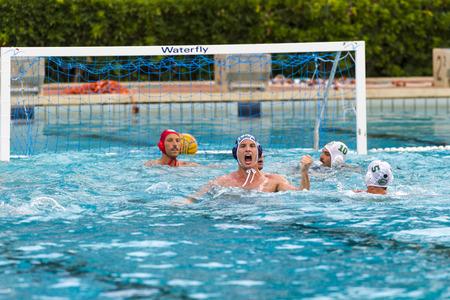 water polo: SIRACUSA, 22 de junio: Andrea Razzi (Bpm Sport Management, gorra oscura) disfrutar después de un gol en el juego BPM Gestión Deportiva -Ortigia Siracusa el 22 de junio de 2014, Siracusa (Italia). Editorial