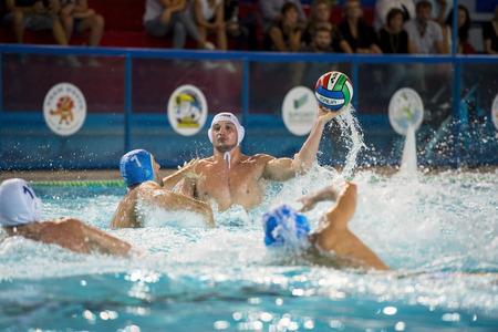 bpm: MANTOVA, SEPTEMBER, 26:  Bini (  Bpm Sport Management )  shooting the ball in game BPM Sport Management - Rari Nantes Bogliasco  - Water Polo Italian Cup,   on September 26, 2014 , Mantova ( Italy). Editorial