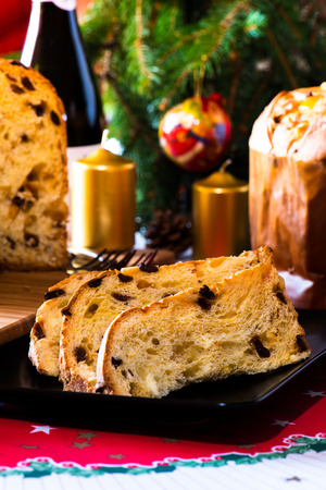 italian typical christmas cake called panettone on table wirh christmas tools Stock Photo