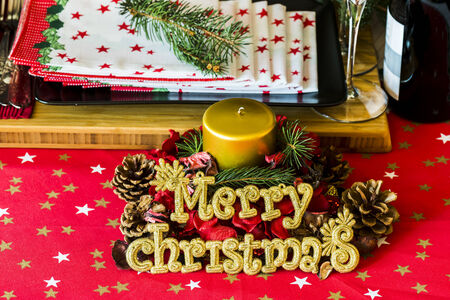 crhristmas tools with gold candel photo