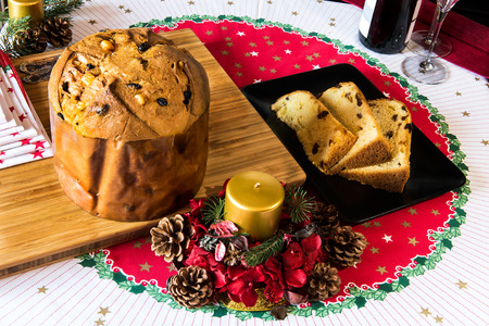 italian typical christmas cake called panettone on table with christmas tools