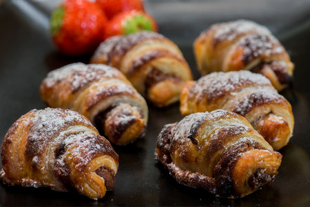 Delicious little chocolat croissants with strawberries and sugar Stock Photo