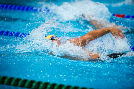 Backstroke Swimmer During A Race On Swimming Pool Photo