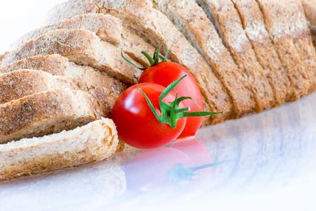 sliced ??bread and red tomato on white background photo