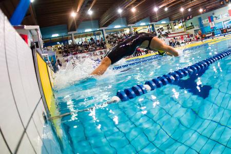 backstroke: MILAN - DECEMBER 23: Veronica Blacks (Italy) starting in backstroke Swimming Meeting Bremen Cup on December 23, 2014 in Milan, Italy.