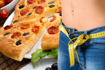 young girl wearing jeans after diet with food background