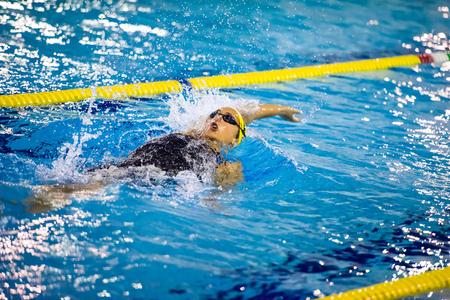 backstroke: MILAN - DECEMBER  23: V. Neri performing backstroke  in  Swimming Meeting Brema Cup on December  23, 2014 in Milan, Italy.
