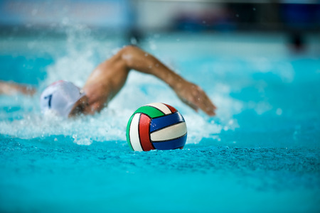 polo sport: water polo ball with player in background Stock Photo