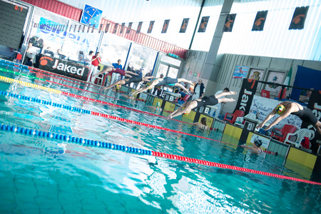 LECCO  (ITALY) - FEBRUARY 19:    Eleonora Costa  ( line 4 ) starting   200 mt freestyle in Italian  Swimming Meeting  on February   19, 2015  in Lecco ( Italy). Editorial
