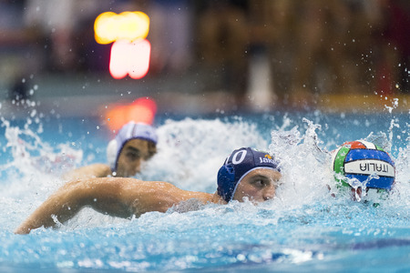 NAPOLI - MAY 12: G. Bini ( Blue cap, Bpm Sport Management) in game BPM Sp. Management vs Acquachiara Napoli  - Italian Water Polo Play Off on May 12, 2015 in Napoli, Italy.