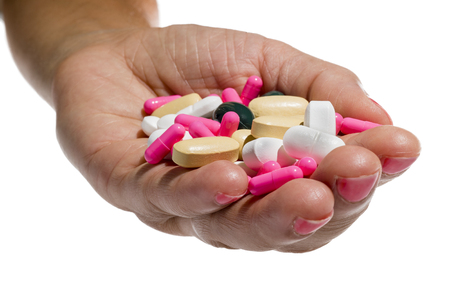 hand with pills  in white background Stock Photo