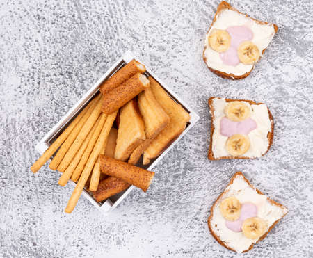 Top view of crackers and toasts on white background horizontal