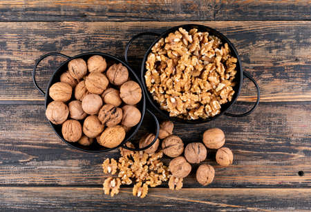 Top view walnuts in baskets on wooden background horizontal