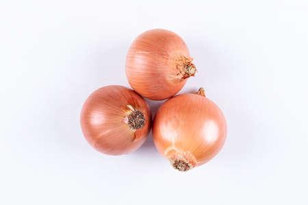 Flat lay 3 onions on white background. horizontal