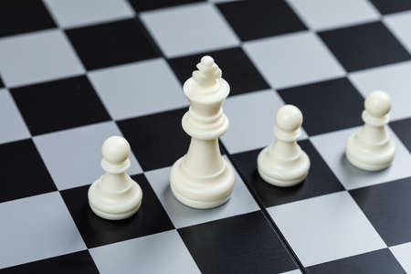 Conceptual of strategy and chess. on checkerboard background high angle view. horizontal image Imagens