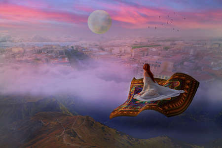 Young woman in a wedding dress flying on a carpet above clouds and city
