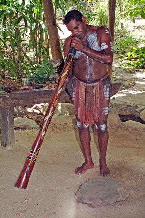 Australia, native Aboriginal didgeridoo playing tradtional instrument named Imagens
